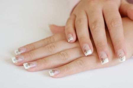 manicured: Closeup of young woman with crossed hands and beautiful long manicured nails