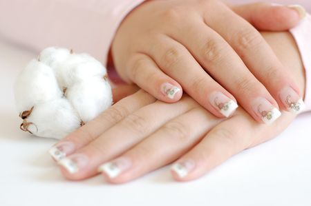 boll: Young woman with beautiful long nails and a cotton boll Stock Photo
