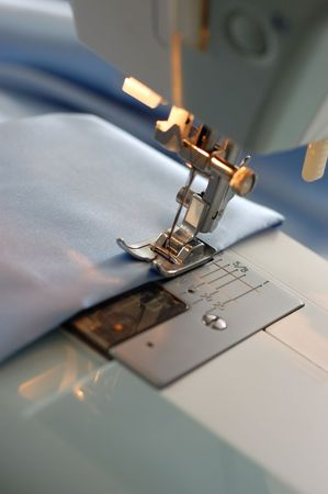Sewing machine detail with the blue thread and cloth Stock Photo