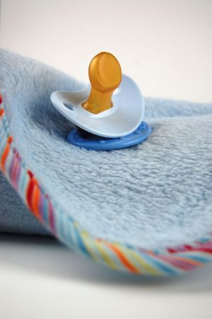 Soft blue baby blanket and pacifier photo