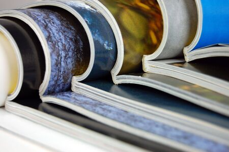mag: Big stack of open color magazines Stock Photo