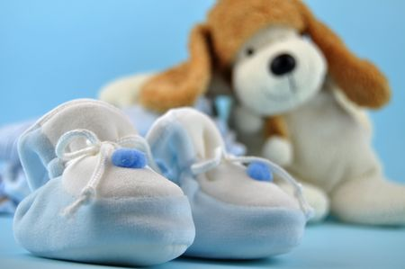 sleepers: Blue baby sleepers and a toy dog