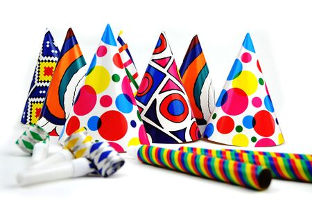 Colorful party hats and whistles on a white background Stock Photo