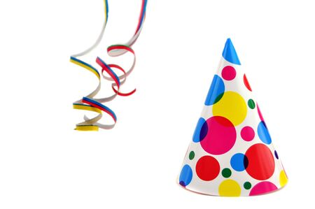 Party hat and colorful curly ribbons Stock Photo