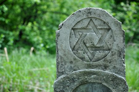 Old tombstone with the star of david Stock Photo