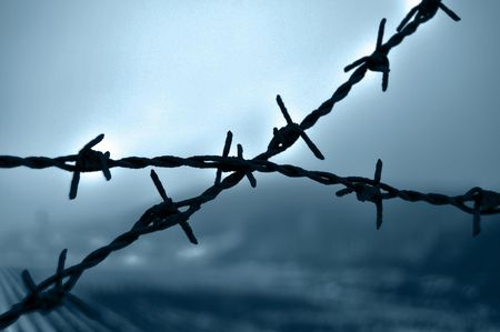 Crossed barb wire closeup Stock Photo - 4845158