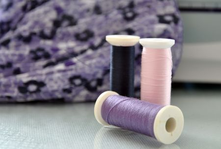 Threads and sewing machine with purple and blue fabric photo