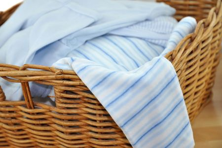 Laundry basket with blue clothes photo