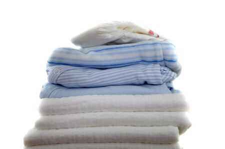 A pile of blue baby clothes and diapers photo