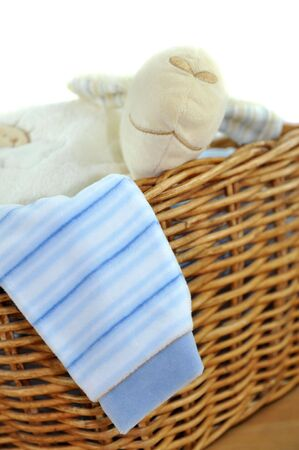 Laundry basket with blue clothes and a toy photo