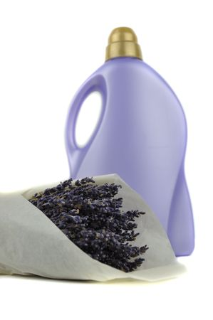 Detergent bottle and a bouquet of dry lavender photo