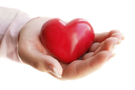 tip: Red wooden heart on a female palm