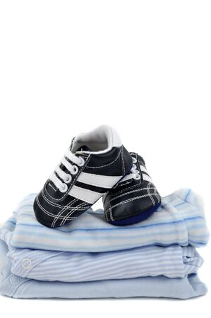 Blue shoes on a pile of clothes, isolated on white Stock Photo - 5142571