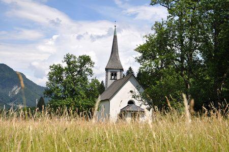 Church in the countryside on a sunny summer day. Mojstrana, Slovenia Stock Photo - 5142580