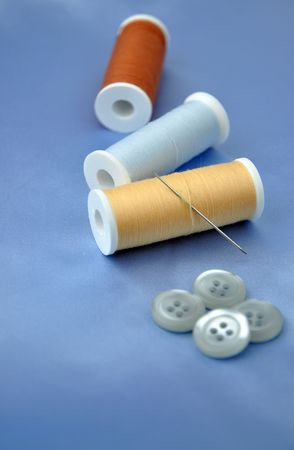 Sewing items on blue silk Stock Photo - 6614049