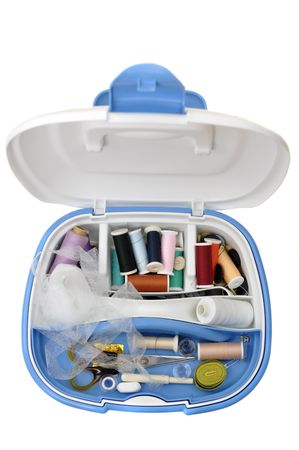 sewing box: Open sewing box full of sewing supplies, isolated on white