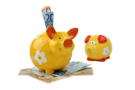 Small empty piggy bank sadly looking at big happy piggy bank full of money Stock Photo - 6791267