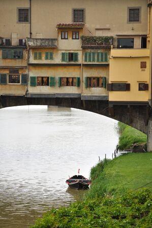 Boat under the Ponte Vecchio photo