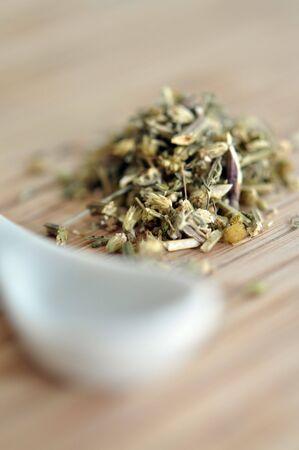 yarrow: Yarrow herbal tea with in white spoon Stock Photo