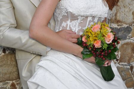 Bride and groom with a bridal bouquet photo
