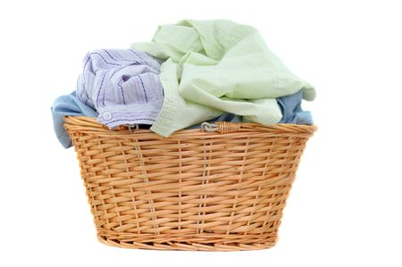 Laundry in a wicker basket, isolated on white  Standard-Bild