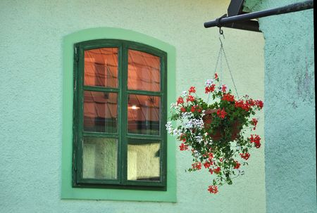 Hanging basket by the window photo