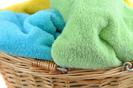 Towels in a wicker basket closeup photo