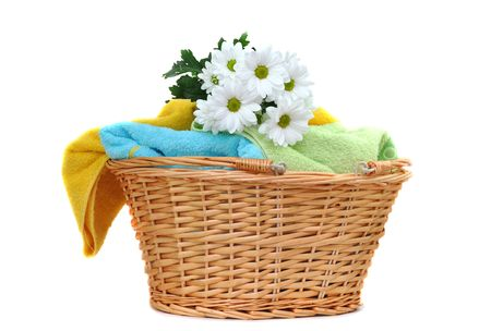 Bouquet of fresh daisies on a pile of fresh towels photo