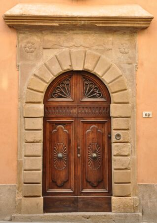Old door in Volterra, Tuscany photo