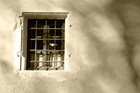 Light in the old window, toned sepia Stock Photo - 8120753