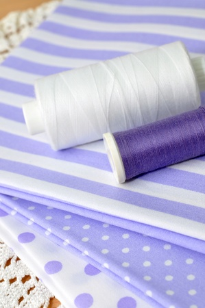 Spools on purple cloth Stock Photo - 8251579