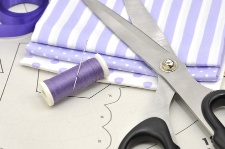 Scissors, spools, needle and textile on sewing plan Stock Photo - 8251574