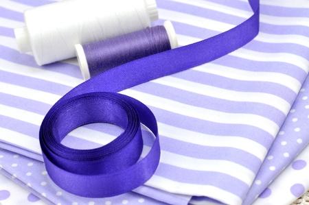 Spools an purple ribbon on textile Stock Photo - 8251580