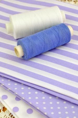 Spools on purple clothes Stock Photo - 8251717
