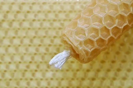 beeswax: Beeswax handmade rolled candle on honeycomb Stock Photo