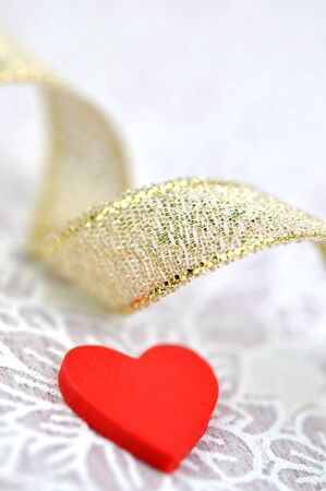 Red heart and golden ribbon photo