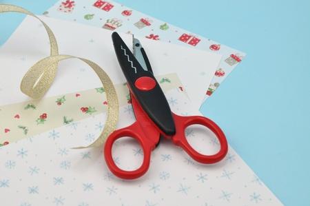 Scissors on Christmas craft paper Stock Photo - 8341432