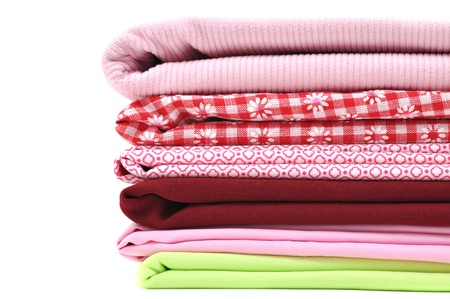 checked fabric: Pile of folded textile, isolated on white  Stock Photo