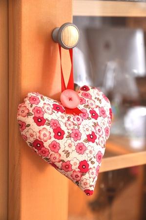 vitrine: Red floral fragrant heart hanging on a vitrine