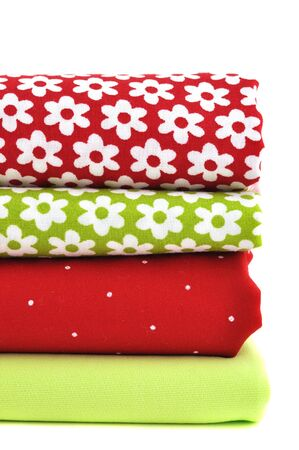 Pile of folded textile, isolated on white Stock Photo - 8557484