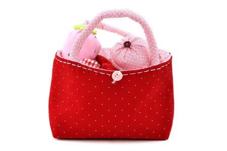 Handmade fabric toys in a red bag photo