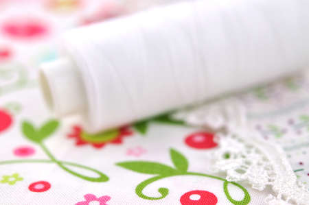White thread on floral fabric Stock Photo - 8907357