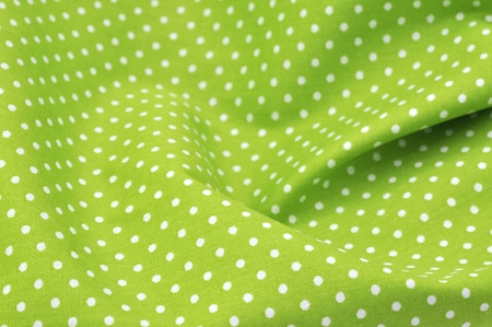 Green polka dot fabric in full frame