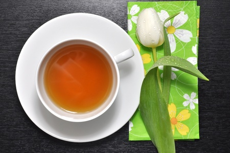 White tulip and a cup of tea