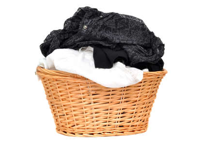 Laundry in a wicker basket, isolated on white Stock Photo - 9157546