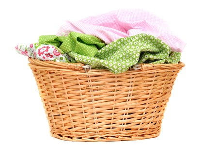 Laundry in a wicker basket, isolated on white Stock Photo - 9157544