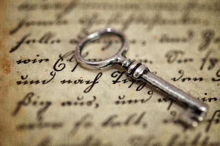 Vintage key on old diary photo
