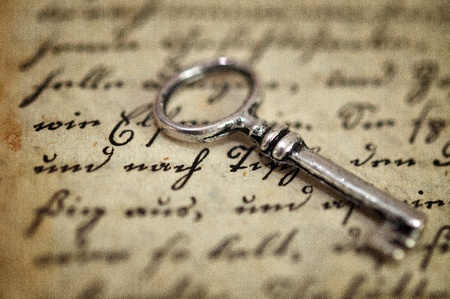 antique key: Vintage key on old diary