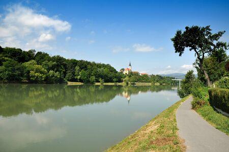 Path by the river. Maribor, Slovenia photo