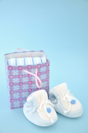 Blue baby slippers and gift bag Stock Photo - 9977294